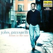 John_pizzarelli-kisses_in_the_rain_span3