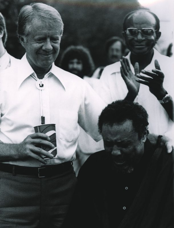 Jimmy Carter comforts a weeping Charles Mingus