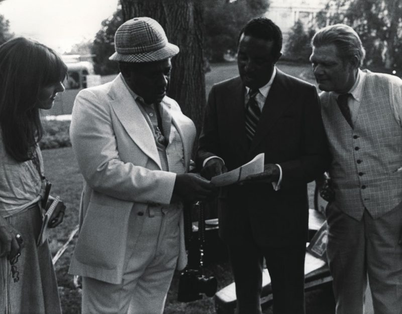 Dizzy Gillespie, Ray Brown and Sims go over some charts