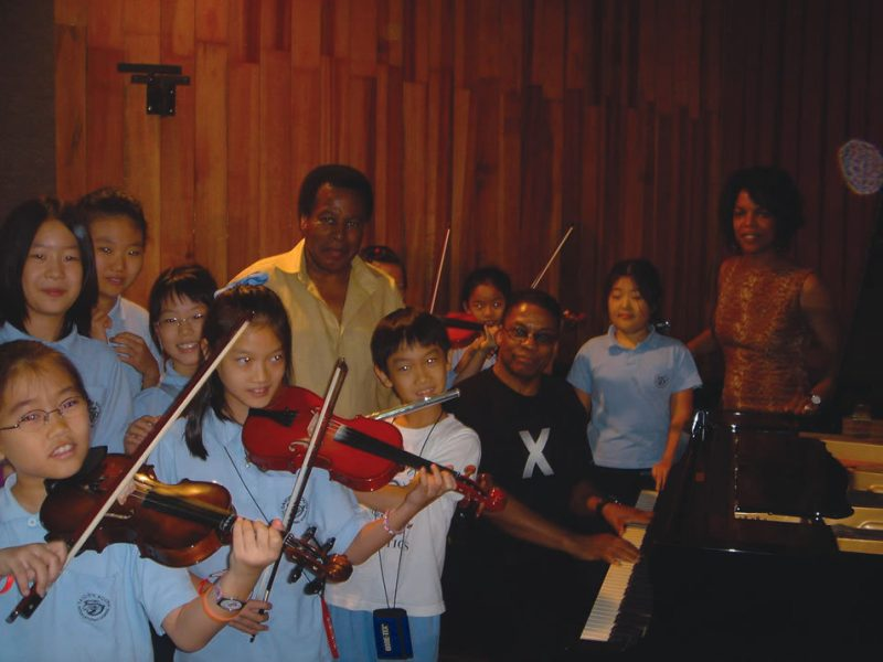 Wayne Shorter, Herbie Hancock and Nnenna Freelon with several young students of the Ho Chi Minh City conservatory of music.
