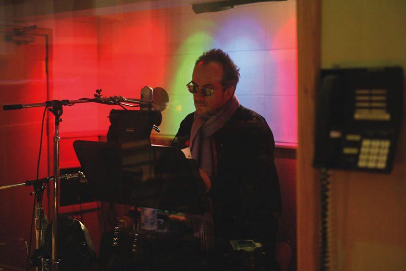 Elvis Costello  in the studio recording A River in Reverse
