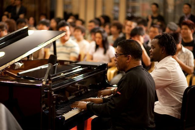 Herbie Hancock and Institute of Jazz Performance student pianist Victor Gould demonstrate improvisation techniques at a standing-room-only master class at Beijing's National Center for the Performing Arts