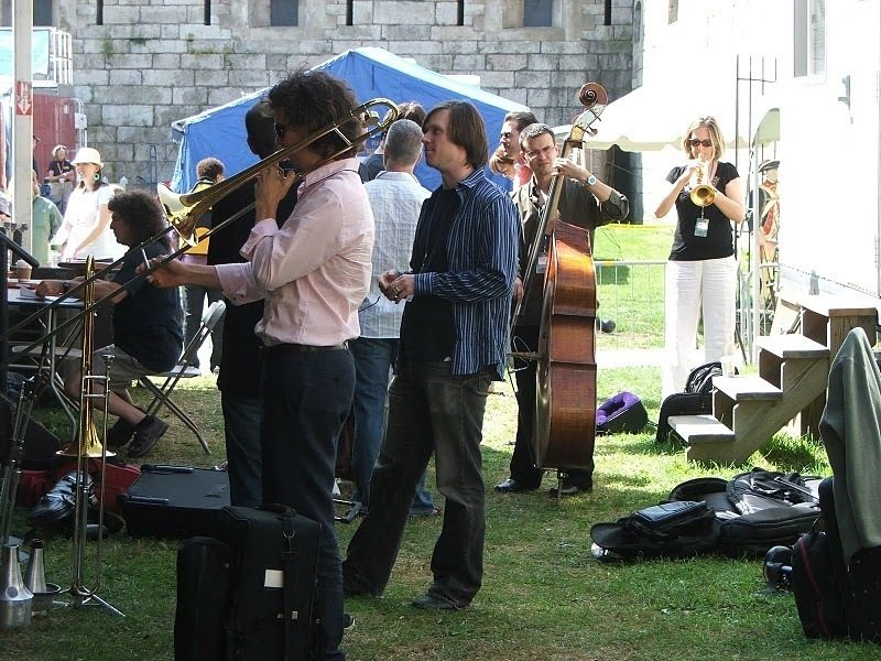 Musicians with Darcy James Argue's Secret Society warming up backstage at CareFusion Newport Jazz Festival