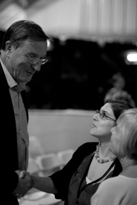 Festival directors Lindsey Turner and Vita Muir greet the auction winner, a parent of a Litchfield Jazz Camper.