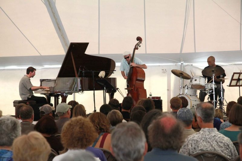 The Fred Hersch Trio gives a free jazz concert under the Medal Day tent in honor of Sonny Rollins. Left to right: Colony Fellow Fred Hersch, bassist John Hebert, and drummer Eric McPherson