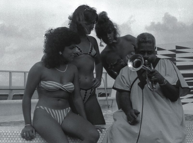 Dizzy Gillespie and admirers hang out on an early jazz cruise