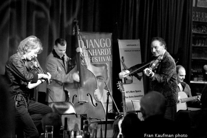 Pierre Blanchard on violin, Xavier Nikci on bass, Dorado Schmitt on violin and Samson Schmitt on guitar at the Django Reinhardt Festival