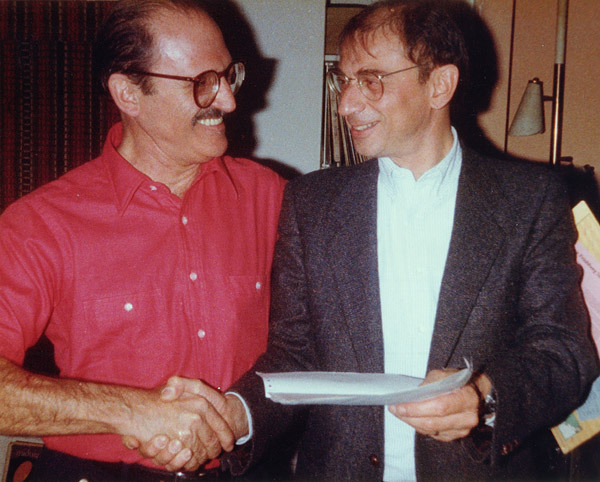 """Al Cohn and Dave Frishberg celebrate royalty checks of $17.21each for their song """"The Underdog"""" in 1984"""
