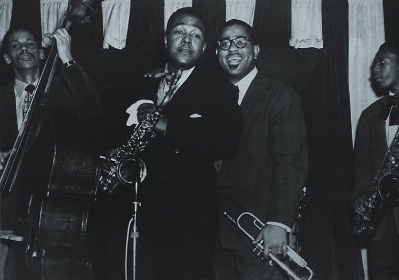 """From Ken Burns' Jazz: Charlie """"Bird"""" Parker and Dizzy Gillespie on stage at Birdland with a young John Coltrane (with sax) and Tommy Potter on Bass from Episode 7 (""""Dedicated to Chaos,"""" 1940-1945)"""