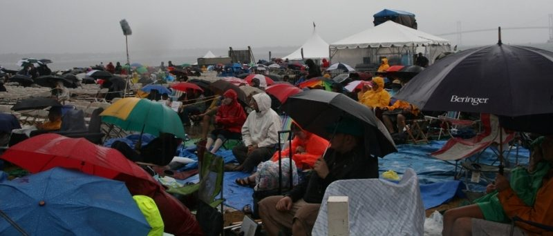 Sunday morning die-hard fans enduring a rainstorm at the 2011 Newport Jazz Festival