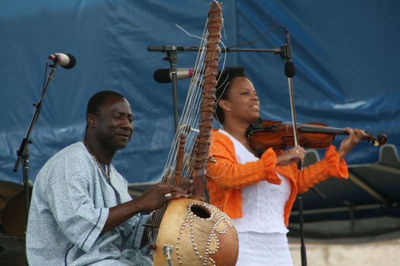 Vacouba Sissoko and Regina Carter performing during the 2011 Newport Jazz Festival