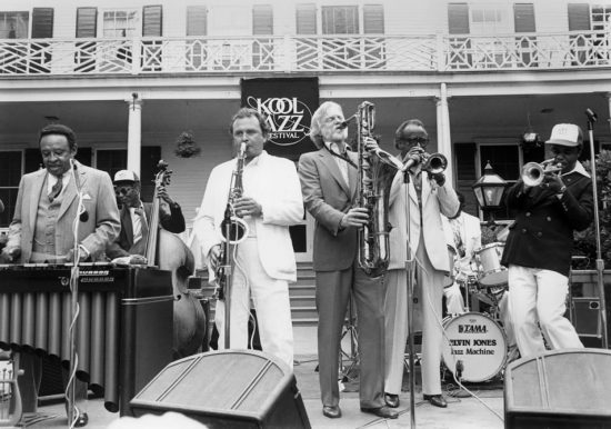 """Opening day at the 1982 Kool Festival in New York City at the mayor's residence, Gracie Mansion. L to R: Lionel Hampton, Bill Pemberton, Stan Getz, Gerry Mulligan, Harry """"Sweets"""" Edison and Freddie Hubbard. image 0"""