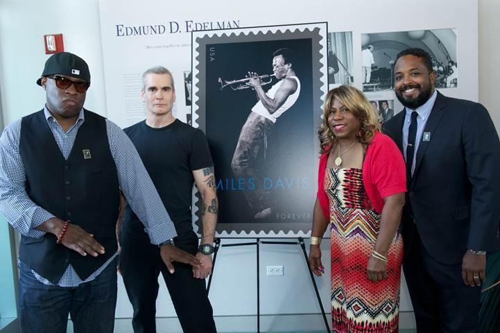 Vince Wilburn, Jr. (nephew of Miles Davis); Henry Rollins; Cheryl Davis (daughter of Miles Davis) and Erin Davis (son of Miles Davis) admire the new Miles Davis commemorative Forever Stamp, Los Angeles, 2012