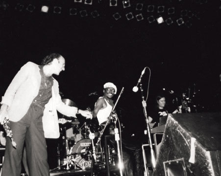 Miles Davis greets Dave Liebman on the bandstand, NYC, 1981