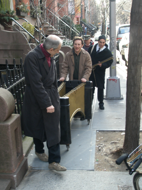 John Mosca, Ari Roland and Stefan Schatz push Teddy Charles' vibes down West 11th Street, as Captain Charles looks on; March 2008