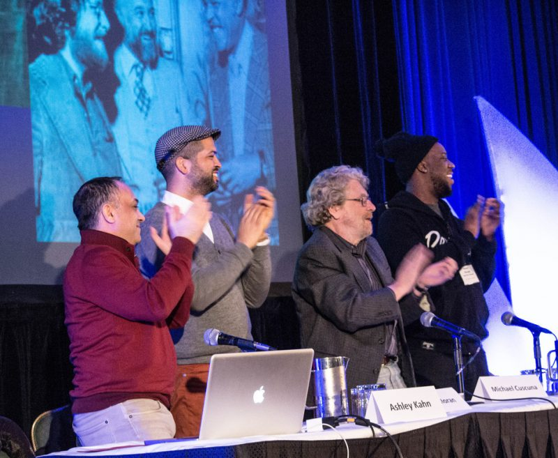 """Ashley Kahn, Jason Moran, Michael Cuscuna and Robert Glasper (l. to r.) applaud the arrival of Bruce Lundvall, former president of Blue Note Records, at the """"Blue Note at 75"""" tribute, Jazz Connect, NYC, Jan. 2014"""