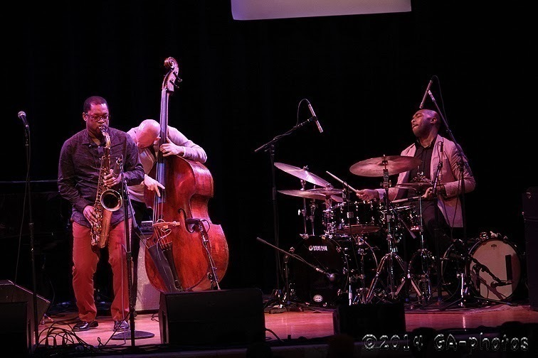 Ravi Coltrane, Alan Hampton and Eric Harland (from left) perform at the Town Hall as part of NYC Winter Jazzfest 2014