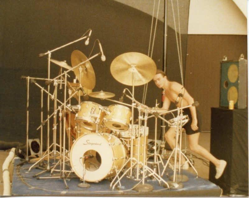 "Peter Erskine: ""Jaco Pastorius jumping up on the drum riser during a Weather Report soundcheck in Honolulu, summer of 1978."""