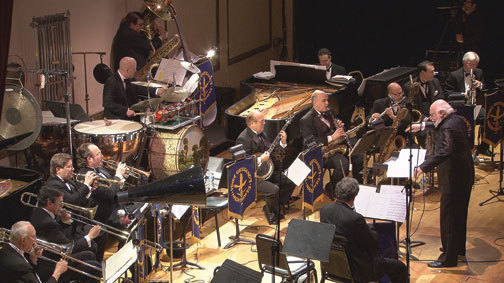 Maurice Peress conducts Vince Giordano and the Nighthawks (and pianist Jeb Patton) at NYC's Town Hall, Feb. 2014. Courtesy of Hudson West Productions.