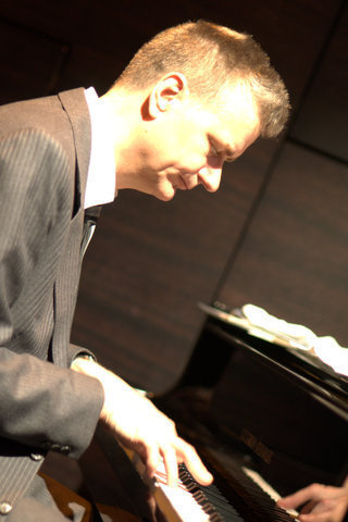 Pianist Alex Webb in performance at St. James Theatre in London