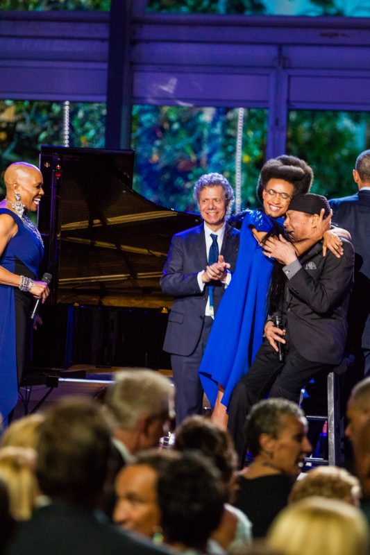 As Dee Dee Bridgewater and Chick Corea look on, Esperanza Spalding embraces Al Jarreau at the International Jazz Day Global Concert at the White House; April 29, 2016.