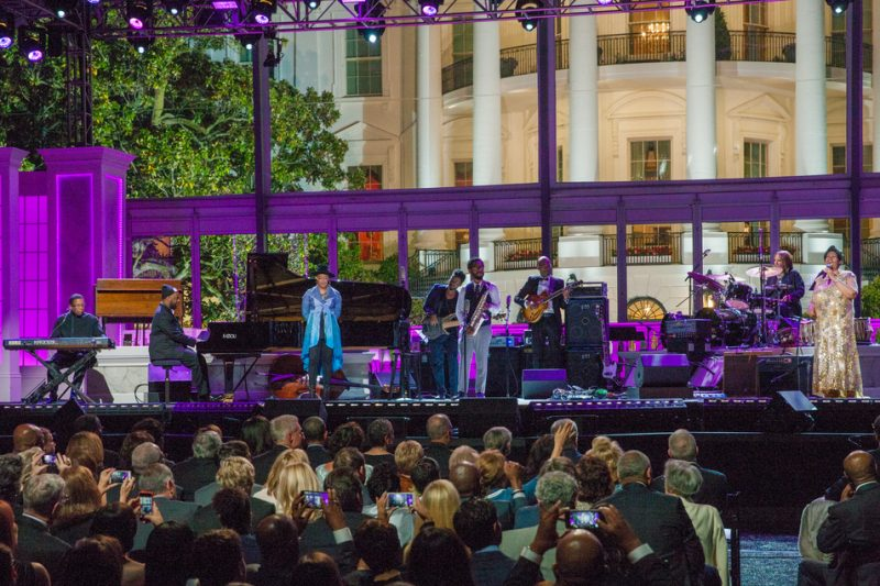 Herbie Hancock (far left) and Aretha Franklin (far right), along with an all-star assemblage of musicians, pay tribute to Prince at the International Jazz Day Global Concert at the White House; April 29, 2016