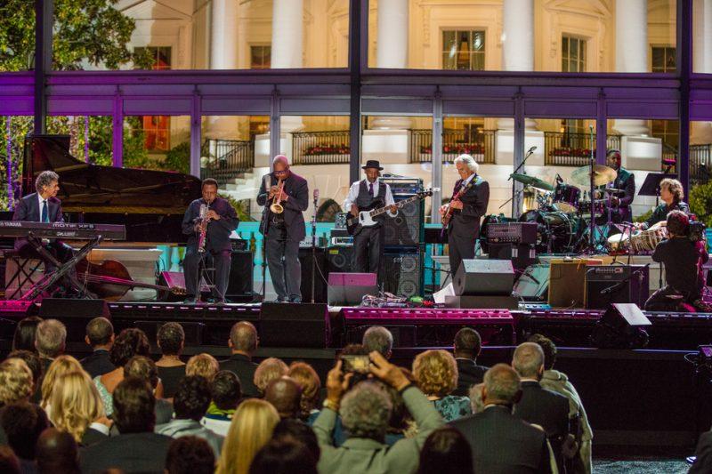 "Chick Corea, Wayne Shorter, Terence Blanchard, Marcus Miller, John McLaughlin, Kendrick Scott and Zakir Hussain (from left) perform Miles' ""Spanish Key"" at the International Jazz Day Global Concert at the White House; April 29, 2016"