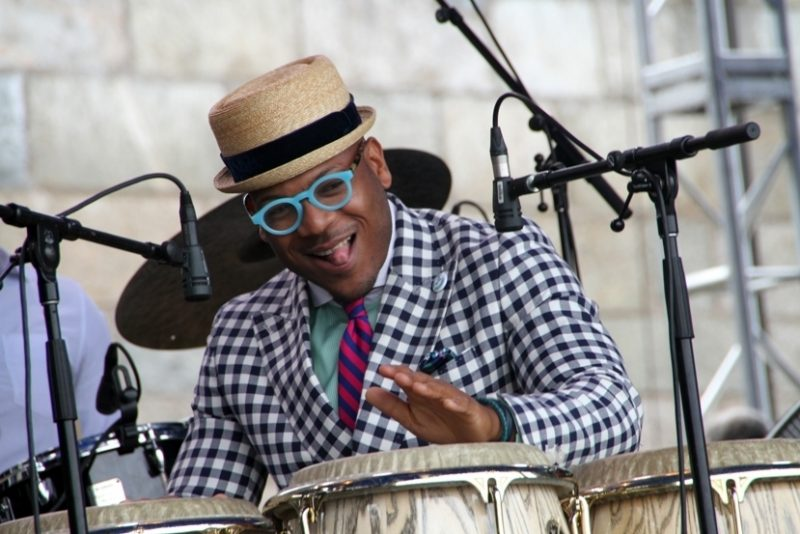 Etienne Charles shifted between trumpet and congas at the 2016 Newport Jazz Festival